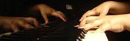 Fingers on piano keys -3
